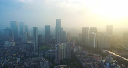 cbd : Aerial view of Chengdu downtown Cityscape in the foggy morning with river and traffics on the road, China Cityscape drone footage