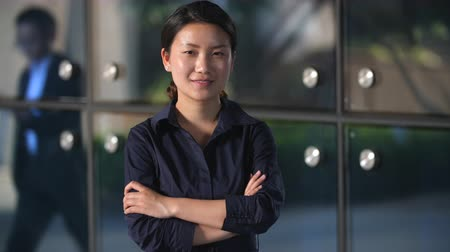 One Young Chinese Businesswoman Looking at Camera with Blank face in Slow Motion