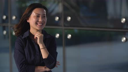 One Young Chinese Businesswoman Smile at Camera in Slow Motion