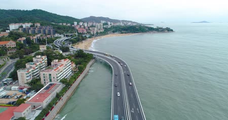 Aerial above view of Xiamen Cityscape of Fujian China, seaside city, cars driving on the highway on the sea, China city 4k drone footage.