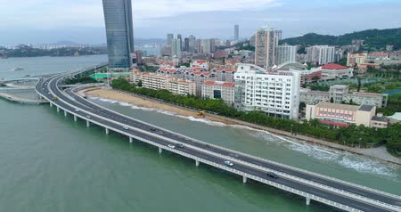 Aerial view of Xiamen Cityscape of Fujian China, seaside city, cars driving on the highway on the sea, China city 4k drone footage. Stock Footage