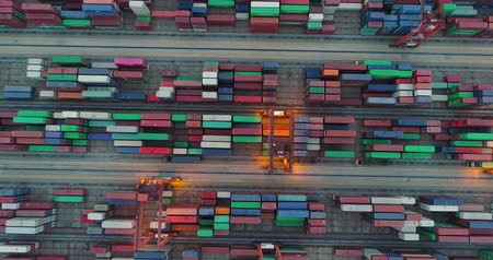 unload : aerial above view of the container port in Shenzhen China in the evening. 4k drone footage of global trade and logistics.