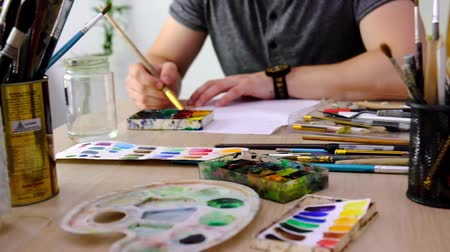 Artist drawing with watercolor paints
