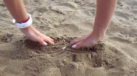 buried : Female hands dig in sand and find gold bitcoin