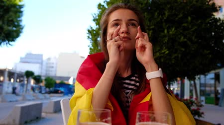 watch tv : Female football fan cheering for Spain