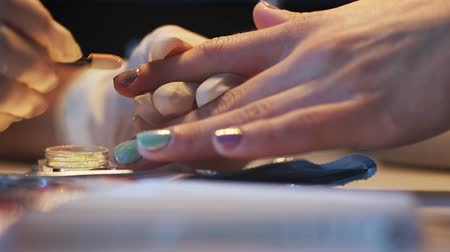 salon : Nail master doing stylish trendy mirror manicure