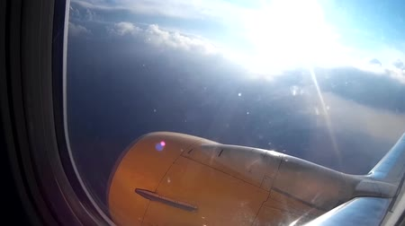 брезент : Looking through the window of the aircraft during flight