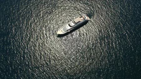 парусное судно : Aerial view to yacht in deep blue sea
