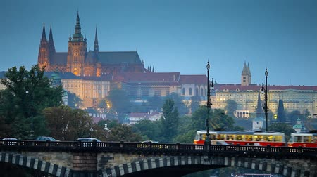 prague bridge : Tram passes over the bridge in Prague Stock Footage