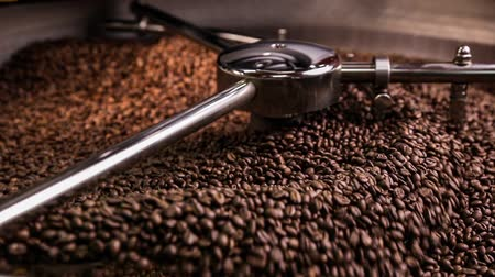 fresh coffee : Mixing roasted coffee Stock Footage