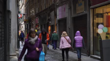 liguria : People walking down the narrow streets of the old city of Genoa, Italy in 4k Stock Footage