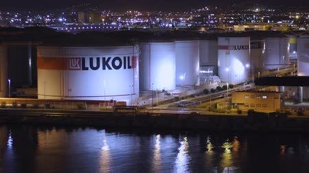 crude : BARCELONA, SPAIN - NOVEMBER 09, 2018 - Lukoil oil storage tanks or containers in the harbour of the city in 4k