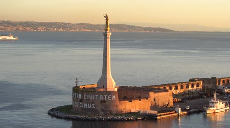 MESSINA, ITALY - NOVEMBER 06, 2018 - Forte del Santissimo Salvatore with statue of Saint Mary or Madonna Della Lettera with the ships and the sea in 4k
