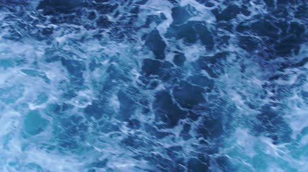 kruvazör : Waves with foam behind a boat. Patterns of waves in water. Water surface wake view from the cruise liner in 4k