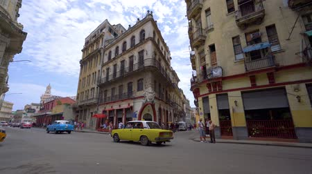 colonial : HAVANA, CUBA - MAY 13, 2018 - People and old taxi cars on the streets in 4k
