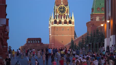 MOSCOW, RUSSIA - 27 JUN, 2019 - Spassky Tower with clock face and people on Red Square in 4k