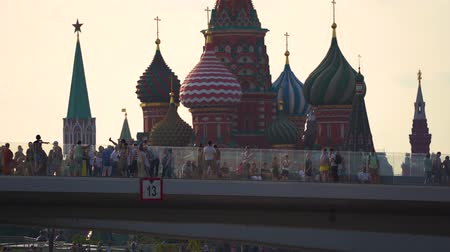 St. Basil Cathedral on Red Square and Spassky tower of the Kremlin from Zaryadie park.