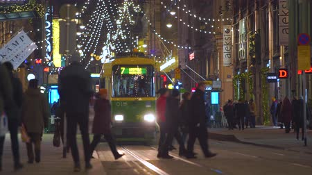 HELSINKI, FINLAND - DEC 20, 2018 - Aleksanterinkatu Street on Christmas time with trams and people Videos