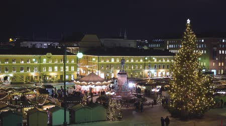 senate square : HELSINKI, FINLAND - DEC 19, 2018 -Winter Senate Square with Christmas Market in 4k
