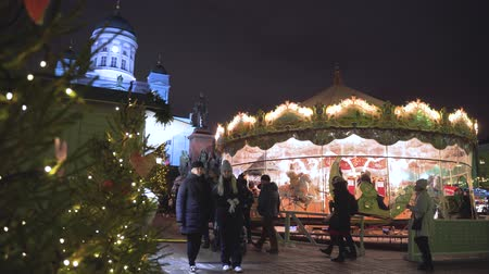 senate square : HELSINKI, FINLAND - DEC 19, 2018 - Carousel on Senate Square with Christmas Market in 4k