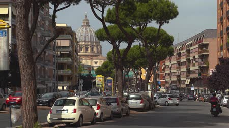 hristiyanlık : ROME, ITALY - 18 JUN, 2019 - People on the streets of Vatican with Saint Peters Basilica cupola background in 4k Stok Video