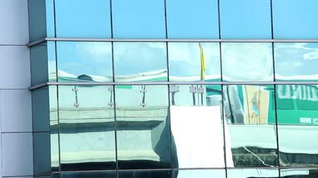 Sky train system in Thailand and its reflect with mirror buliding