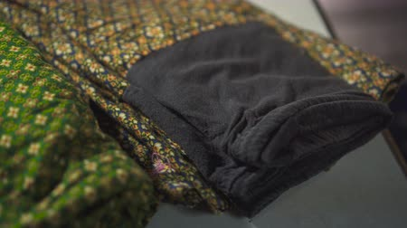 eski moda : Slowly pan shot of a pants with thai pattern on fabric.