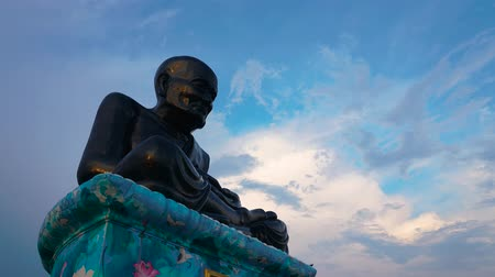 legendary : Time-lapse of Luang Pu Thuat Statue, The legendary monk statue above with sky.