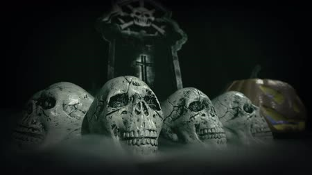jack olantern : Old film look of halloween set decoration with skulls, grave and jack olantern - still shot