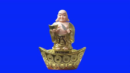 happiness symbol : Smiling buddha figure nod and blow a folding fan. Blue Screen.