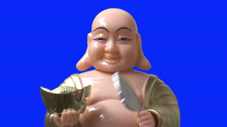 shui : Smiling buddha figure nod and blow a folding fan. Close Up. Blue Screen.