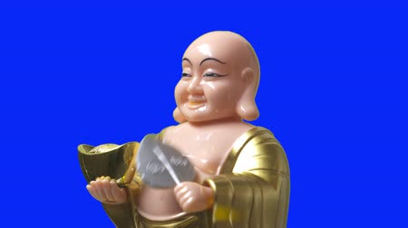 happiness symbol : Smiling buddha figure nod and blow a folding fan. Close Up. Side view.