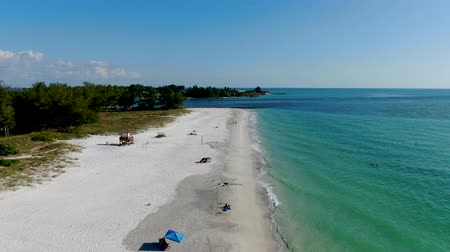 carolina : Aerial view of Coquina Beach white sand beach and turquoise water in Bradenton Beach during blue summer day, Anna Maria Island, Florida. USA Stock Footage