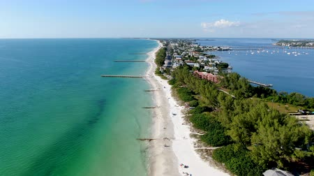 sand bank : Aerial view of Coquina Beach white sand beach and turquoise water in Bradenton Beach during blue summer day, Anna Maria Island, Florida. USA Stock Footage