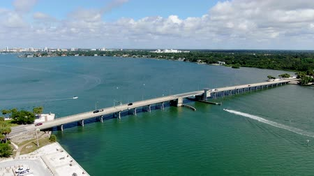 motor vehicle : Aerial view of open street bridge crossing ocean with small boat and linking Island Bay and Sarasota, Florida, USA