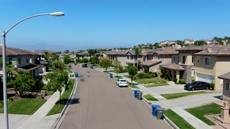 neighbor : Suburban neighborhood street with big villas next to each other in Black Mountain, San Diego, California, USA. Aerial view of residential modern subdivision luxury house. Stock Footage