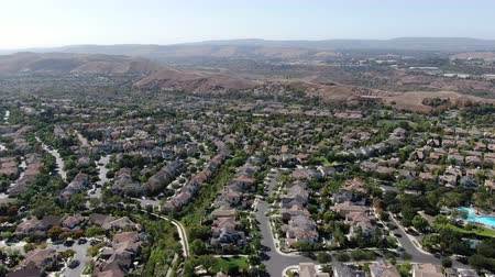 same : Aerial view of master-planned community and census-designated Ladera Ranch, South Orange County, California. Large-scale residential neighborhood