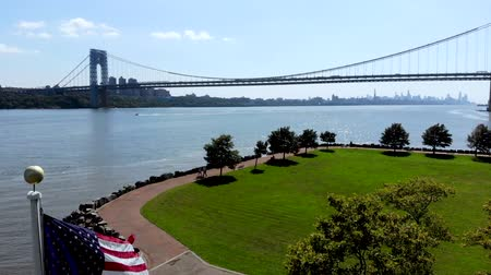 kolumna : Aerial view of American flag with George Washington Bridge in Fort Lee, New Jersey on the background. USA