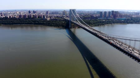 fort lee : Aerial view of George Washington Bridge in Fort Lee, NJ. George Washington Bridge is a suspension bridge spanning the Hudson River connecting New Jersey to Manhattan New York Stock Footage