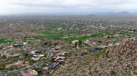 felosztás : Aerial view above golf course and upscale luxury homes in Scottsdale, Phoenix, Arizona
