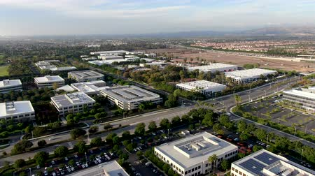 összetett : Aerial view of business and finance district with new office building surrounded by parking and road. Irvine Business Complex. Irvine California. USA