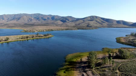 recursos : Aerial view of Otay Lake Reservoir with blue sky and mountain on the background, Chula Vista, California. USA