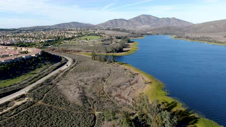 irrigate : Aerial view of Otay Lake Reservoir with residential house and mountain on the background during sunny day, Chula Vista, California. USA