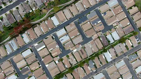realty : Aerial view of urban sprawl. Suburban packed homes neighborhood with road. Vast subdivision in Irvine, California, USA
