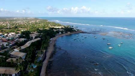 brezilya : Praia Do Forte coastline with beach and blue clear sea water, Bahia, Brazil. Stok Video