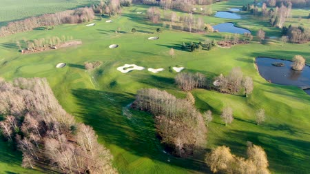 фарватер : Aerial view of a golf course. Colorful trees and green course during autumn season in the South of Belgium, Walloon Brabant.