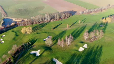Aerial view of a golf course. Colorful trees and green course during autumn season in the South of Belgium, Walloon Brabant.