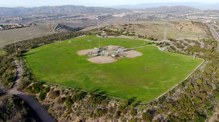 Aerial top view of Community park baseball sports field. Black Mountain Ranch Park, San Diego, USA Стоковые видеозаписи