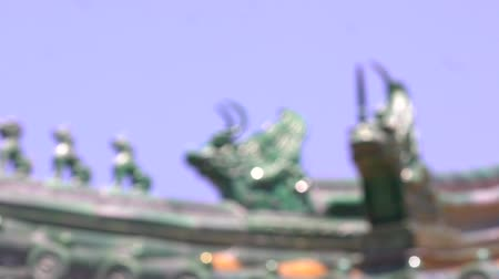 Traditional figures on Chinese roof ancient architecture with hblue sky background in Beijing, China,