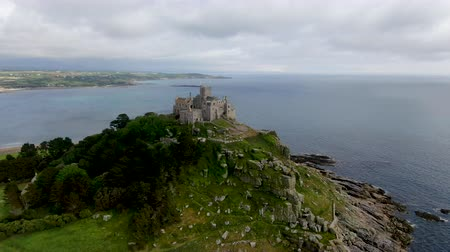 michael : St Michaels Mount is a small tidal island in Mounts Bay, Cornwall, England, United Kingdom. Castle and chapel on the top of the mount. September 22nd, 2020